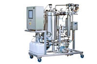 This image shows pH sensors being used in a process skid that includes a dosing system.